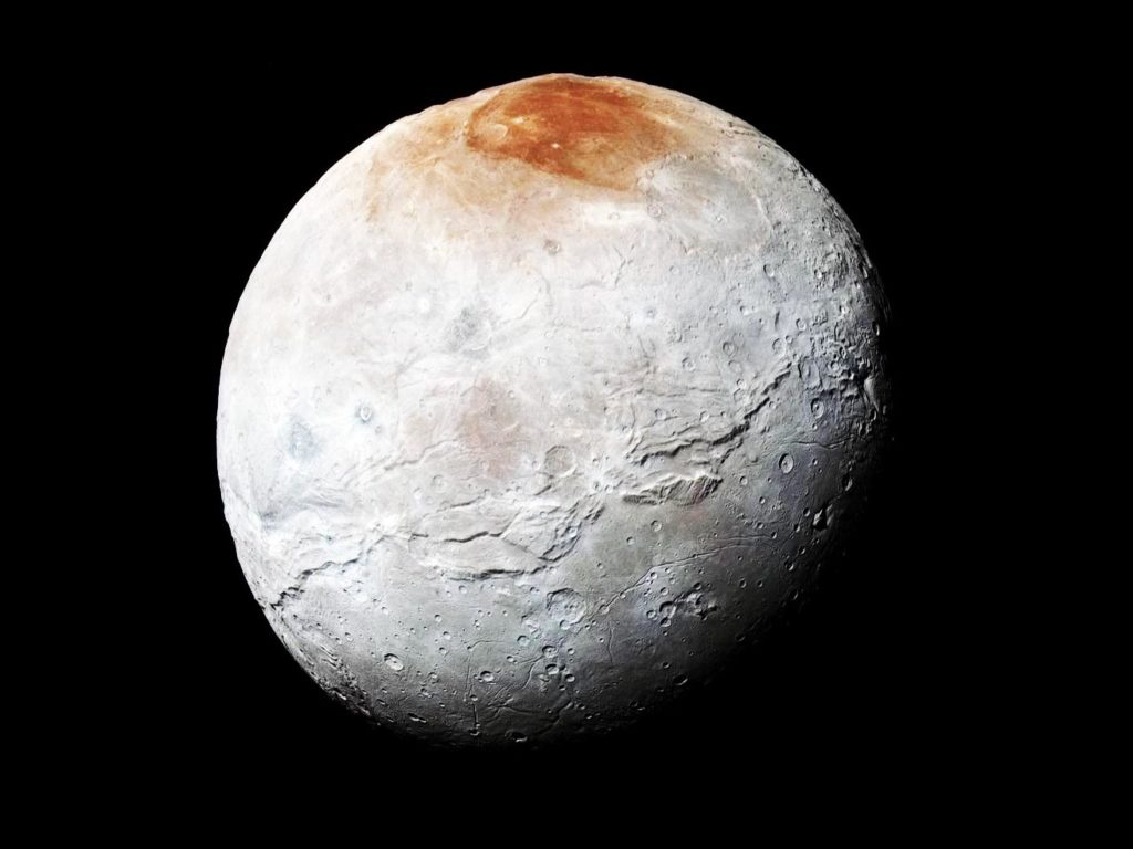 La extraña mancha roja en la luna de Plutón